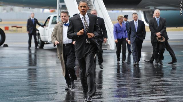 Obama takes digs at Perry, GOP debate audiences