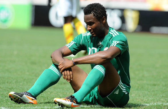 John Obi Mikel cuts a forlorn figure after Nigeria failed to reach the 2012 Africa Cup of Nations over the weekend.