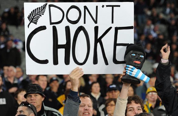New Zealand fans hold up a banner urging the All Blacks not to choke during their clash with Argentina.