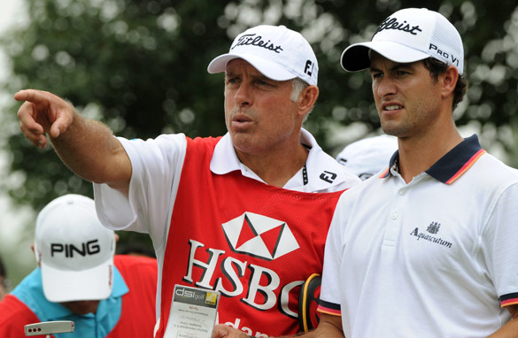 Under-fire caddy Steve Williams has been supported by his new employer, Australian golfer Adam Scott.