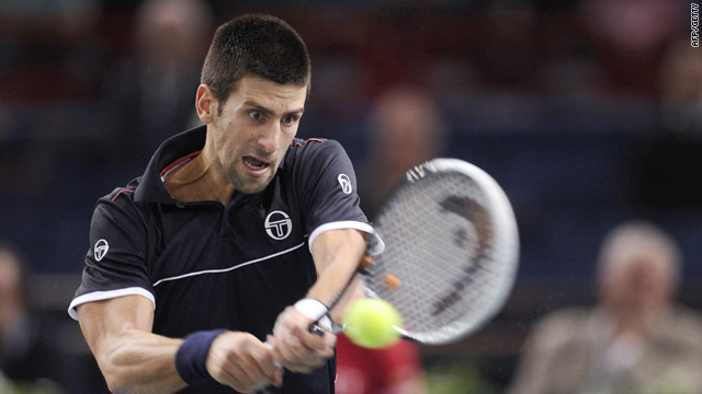 Novak Djokovic plays a return during his third round win over Victor Troicki in Paris.