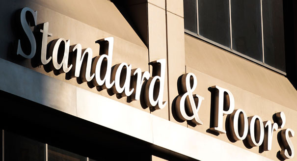 S&P downgrades dozens of banks