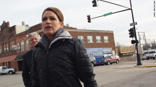 Battle of the buses: Bachmann, Perry cross paths