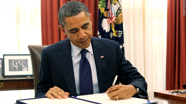 Obama signs payroll tax cut extension and heads to Hawaii