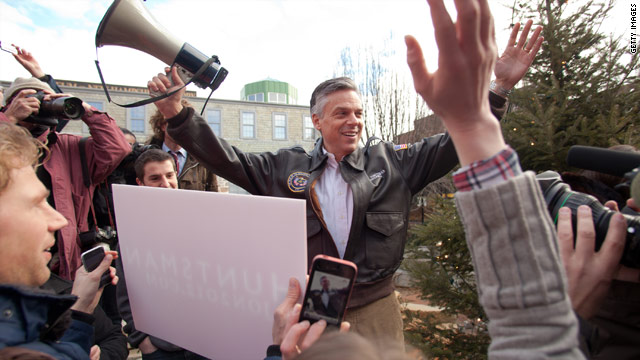 Romney, Huntsman tie in midnight New Hampshire vote