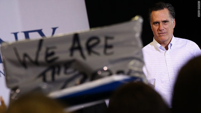 Romney pushes back after protesters interrupt rally