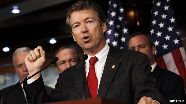 Rand Paul cuts check to Treasury Department