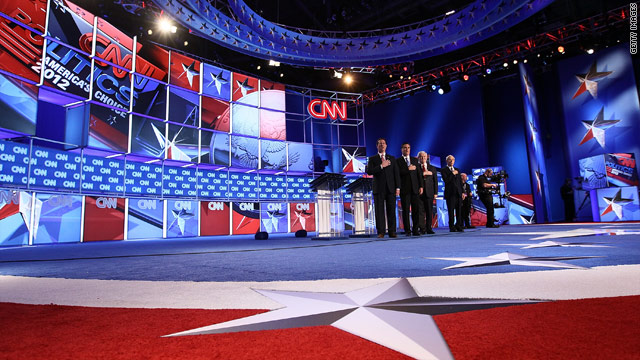 Santorum tries to shoulder past Romney, Gingrich in debate