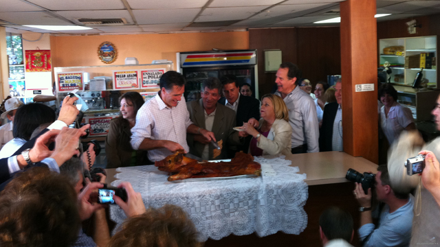 Photo: Romney cuts into a pig