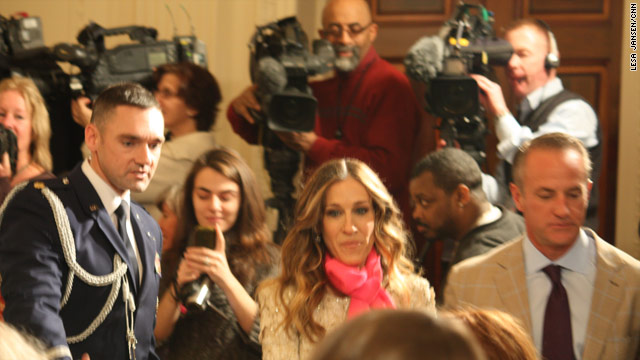 The movie star switches roles with paparazzi at White House