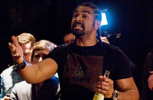 David Haye smashed his beer bottle on Dereck Chisora as they brawled in Munich at a press conference. (Getty Images)