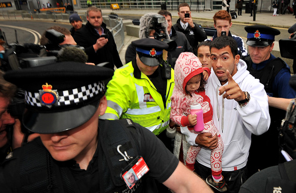 Carlos Tevez had a police escort when he arrived back at Manchester airport on February 14. (Getty Images)