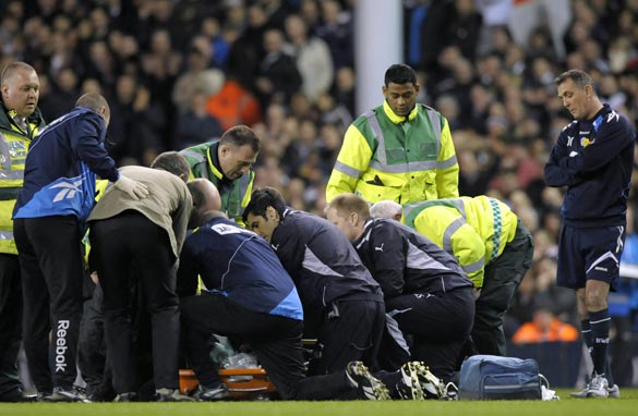 Bolton manager Owen Coyle watches on as his player Fabrice Muamba receives urgent medical attention at White Hart Lane.