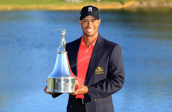 Tiger Woods shows off the Bay Hill trophy for the seventh time and will be eyeing a fifth Masters victory at Augusta.