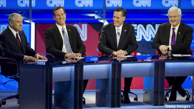 Despite long odds, Romney rivals standing firm