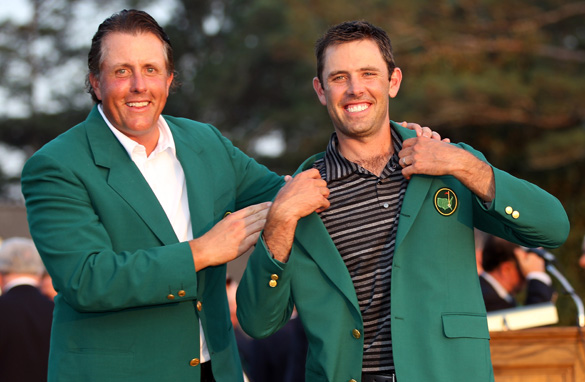 Will Charl Schwartzel, right, be able to don another Green Jacket at the Masters this weekend? (Getty Images)