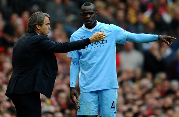 Manchester City boss Roberto Mancini, left, has finally lost patience with Mario Balotelli. (Getty Images)
