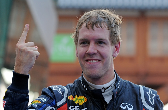 Sebastian Vettel with his familiar No.1 pose from his all-conquering 2011 season.