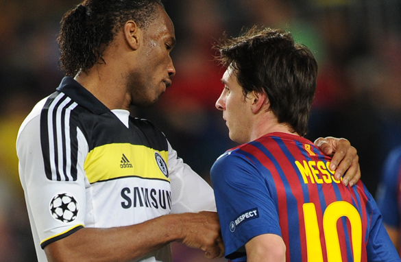 Chelsea&#039;s Didier Drogba, left, commiserates with Barcelona&#039;s Lionel Messi, who missed a penalty. (AFP/Getty Images)