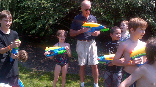 Biden drenched by children with super-soakers