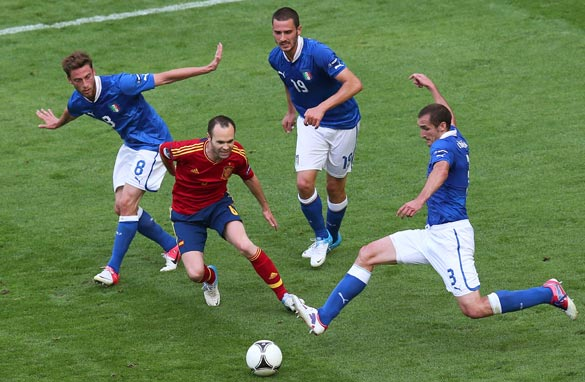Spain's Andres Iniesta (center) is crowded out after another attack comes to an end. (Getty Images)