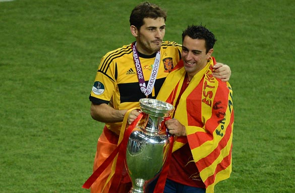 United in triumph: Captain Iker Casillas (left) and Xavi celebrate an historic success.
