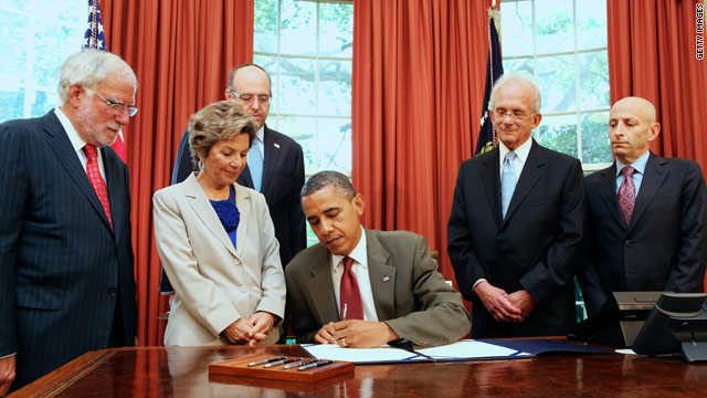 Obama signs U.S.-Israel security act on eve of Romney trip