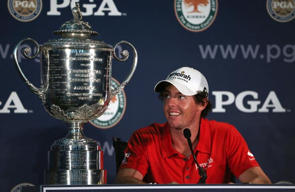 Rory McIlroy is dwarfed by the PGA Championship trophy after the second major win of his career. (Getty Images)