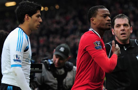 All eyes will be on Patrice Evra and Luis Suarez during Sunday's game at Anfield.