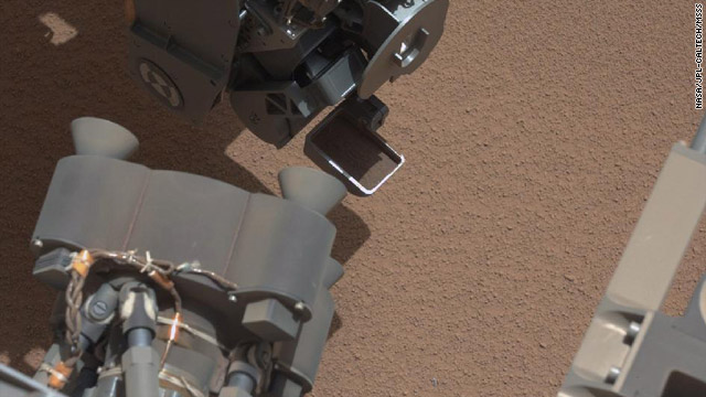 View of Curiosity's First Scoop Also Shows Bright Object