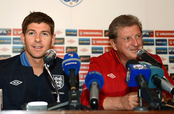 International coaches like England's Roy Hodgson (right) get just a few days with stars like Steven Gerrard (left).