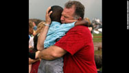 Neighbor comforts 3-year-old tornado survivor