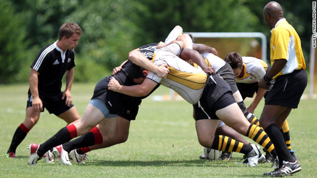 Rugby teams from across the southeastern U.S. met up for the Hotlanta Sevens Rugby Tournament in Cumming, Georgia, on Saturday, July 9, 2011. The University of Georgia (black jerseys) and Georgia Institute of Technology (yellow jerseys) rugby teams collide at the beginning of their game.