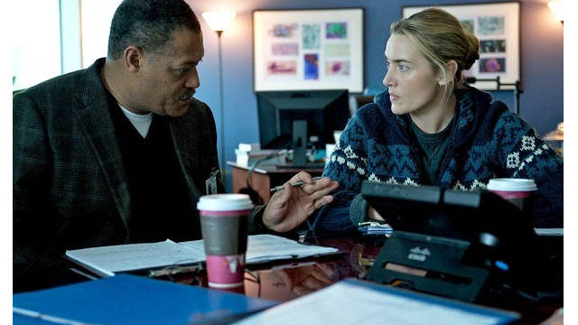 Laurence Fishburn and Kate Winslet in a scene from the Warner Bros. movie