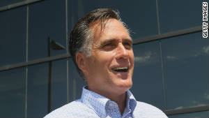 Mitt Romney arrives for a business roundtable to discuss the economy during an August 10 campaign stop in Pella, Iowa.