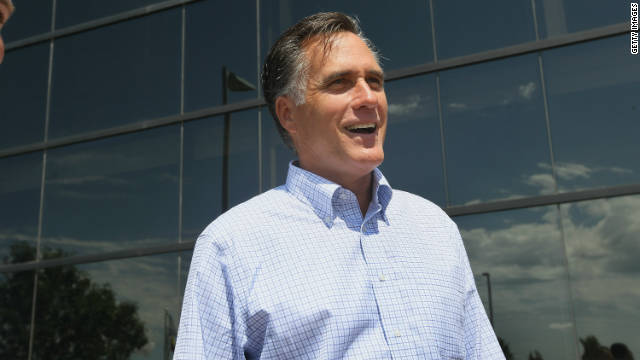 Mitt Romney arrives for a business roundtable to discuss the economy during a campaign stop in Pella, Iowa.