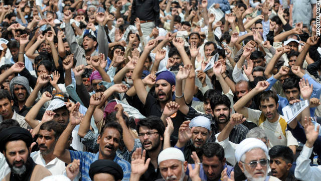 Pakistani Shiite Muslims chant slogans against Israel and the U.S. during a procession in Karachi on August 22.