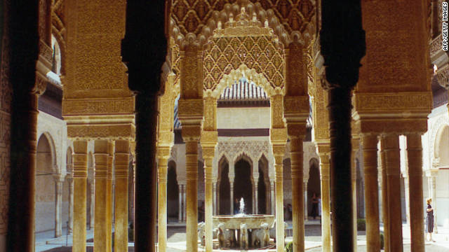 "Alhmabra (meaning ""red one"") is a huge palace complex decorated with intricate Moorish architectural flourishes."