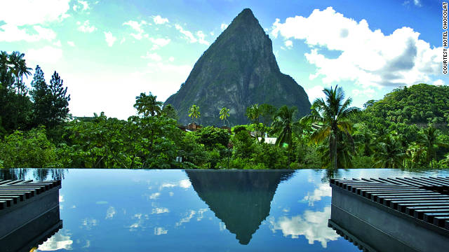 Hotel Chocolat's pool reflects the iconic Pitons and surrounding rain forest in Soufrière, St. Lucia like an overflowing mirror. See more photos on <a href='http://www.budgettravel.com/slideshow/photos-worlds-most-amazing-hotel-pools,6271/' target='_blank'>BudgetTravel.com</a>.