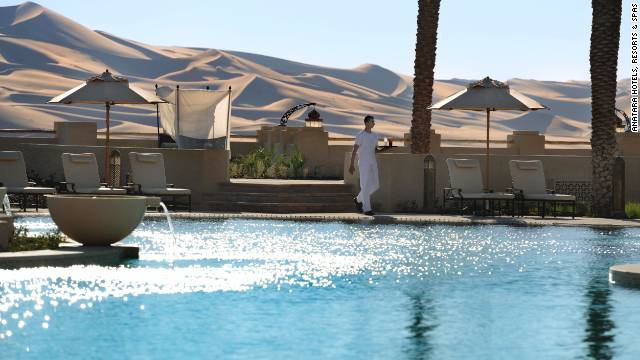 The Qasr Al Sarab resort materializes in the middle of the tall, curling dunes of the Liwa Desert in Abu Dhabi. See more photos on <a href='http://www.budgettravel.com/slideshow/photos-worlds-most-amazing-hotel-pools,6271/' target='_blank'>BudgetTravel.com</a>.