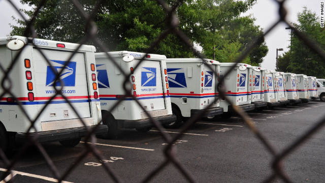 U.S. Postal Service mail delivery trucks sit idle at a Manassas post office in Virginia.
