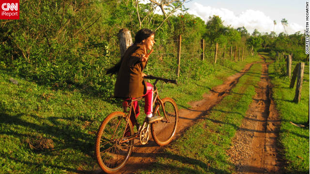 iReporter Kristin McCarthy took this photo of a girl riding a bike during a Peace Corps experience in Paraguay.