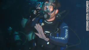NASCAR driver Brian Vickers goes for a dive at the Georgia Aquarium in Atlanta.