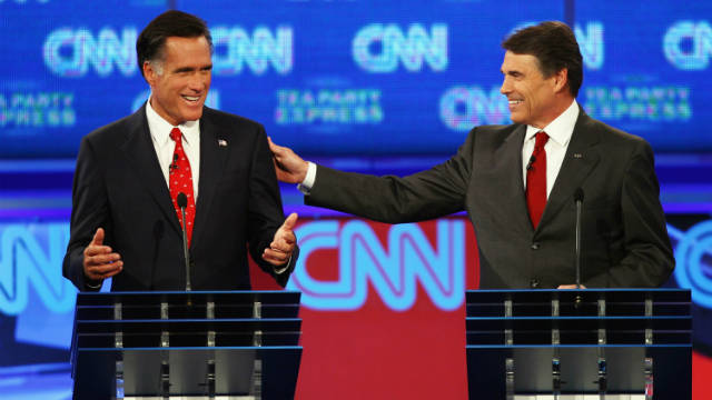 Rick Perry touches Mitt Romney's shoulder at CNN/Tea Party debate Monday.