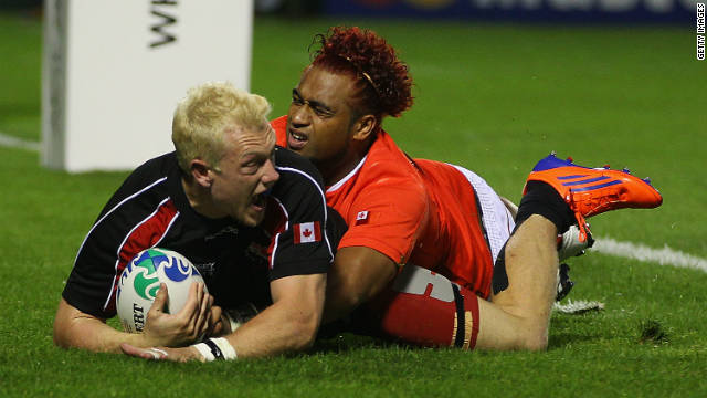 Phil Mackenzie roars with delight as his late try secures victory for Canada over Tonga on Wednesday.