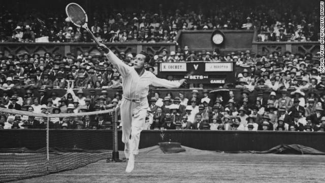 "Cochet, known as ""the Ball Boy of Lyon,"" returns a shot against Borotra in the semifinals at the 1925 Wimbledon Championships. Borotra won, but lost in the final to Lacoste."