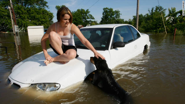 When the Mississippi River flooded parts of Missouri, Alexae Dunn and her dog Lady were surrounded by waist-high water.