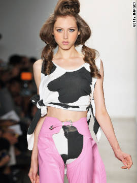 A fashion model hits the runway at Milk Studios.