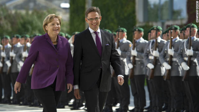 German Chancellor Angela Merkel (L) and Finland's Prime Minister Jyrki Katainen inspects the guard of honour before their meeting at the Chancellery in Berlin on September 13 , 2011.
