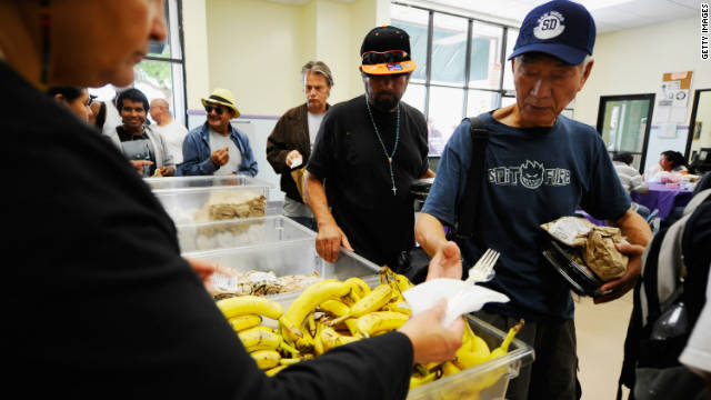People pick up lunch in the soup kitchen of St. Francis Center on September 13 in Los Angeles, California.